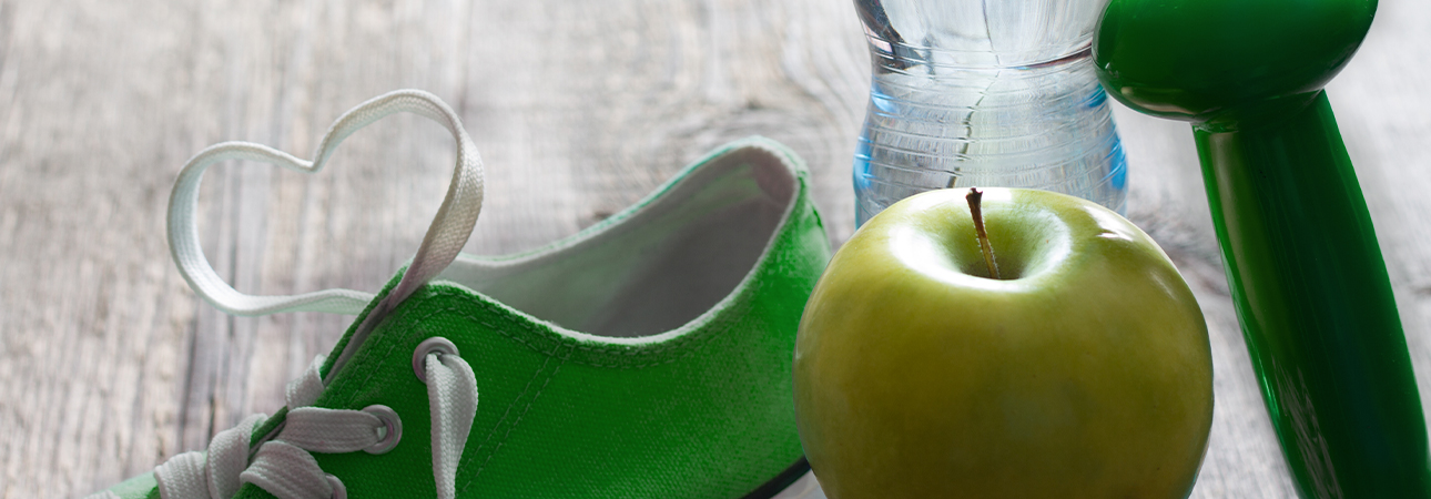 Image of a bottle of water, a shoe, and an apple