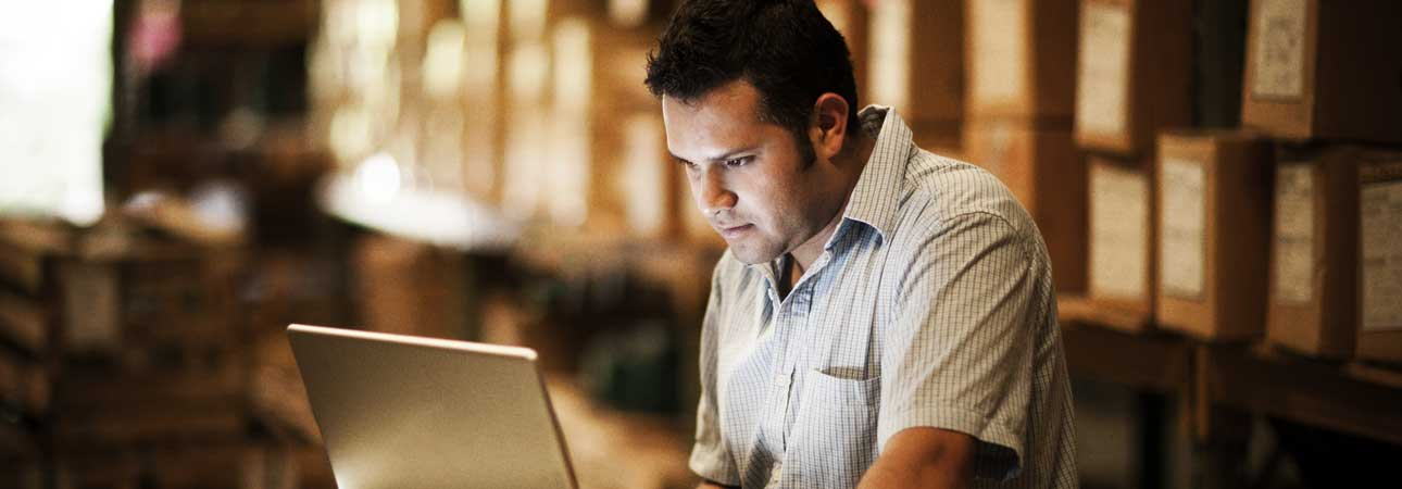 Man looking at a laptop intently