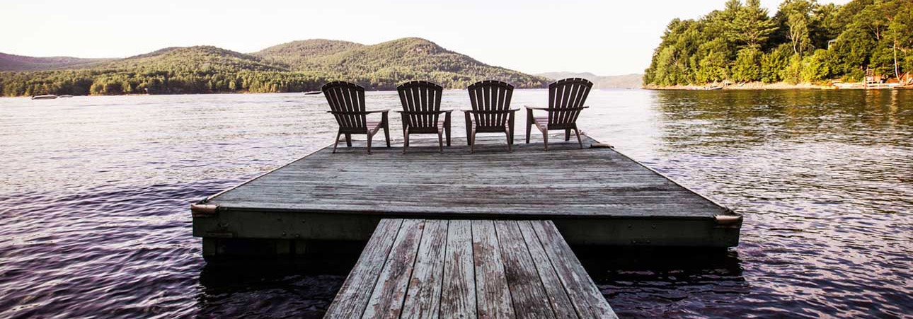 Picture of adirondack chairs overlooking a lake