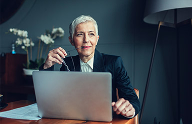 Older business woman looking at a laptop